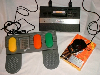 "Photo of an ""optimal"" game setup consisting of Thrust+ Platinum on cartridge, an Atari 2600, Driving Controller and FOOTPEDAL."